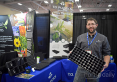 Jaired Rusch with T.O. Plastics shows the companies new tray