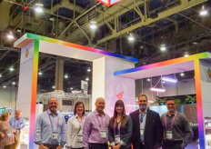 Eric Moody, Christine Stein, Megan Foley, Todd Philips, James Grouzos, Steven Szewczyk in the colourful and bright booth of P.L. Light Systems.