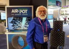 Tom Robertson with Air-Pots. Thanks to the shape of the pots, the plants are enhanced to develop a mass of healthy fibrous roots.